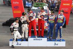 Podium: winners Sébastien Ogier and Julien Ingrassia, second place Petter Solberg and Philip Mills, third place, Jari-Matti Latvala and Mikka Anttila