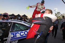 2010 GS champions Charles Putman and Charles Espenlaub celebrate with Andrew Hendricks