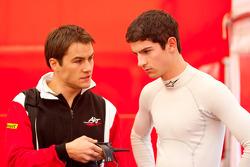 Alexander Rossi talks to an engineer