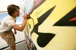 Roberto Merhi signing some art work