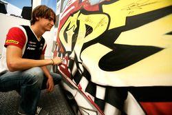 Esteban Gutierrez signing some art work