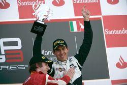 Robert Wickens celebrates victory on the podium with Mirko Bortolotti