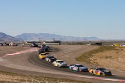 Eric Holmes leads a group of cars