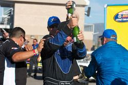 Victory lane: race winner Greg Pursley celebrates with champagne