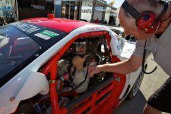 GT pole winner Eric Curran celebrates