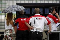 Formula Two engineers study the times on the pit wall