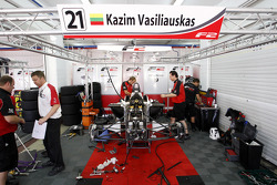 F2 engineers work to fix the car of Kazim Vasiliauskas after his accident