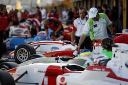 Formula Two cars line-up in the pit lane