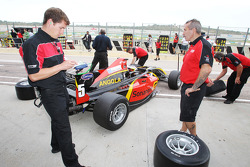 F2 engineers work on the cars of Ricardo Teixeira