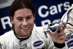 Kelvin Snoeks met zijn eigen Minichamps modelauto
