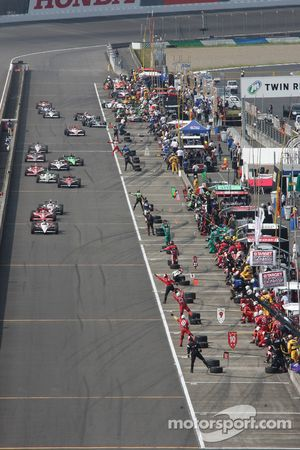 Helio Castroneves, Team Penske leads the field on pitlane