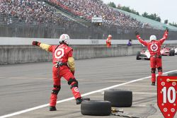 Chip Ganassi Racing team members signal to their driver
