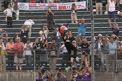 Race winner Helio Castroneves, Team Penske celebrates Spiderman style