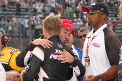 Race winner Helio Castroneves, Team Penske celebrates with Ryan Briscoe, Team Penske