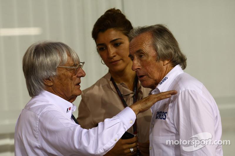 Bernie Ecclestone con su novia Fabiana Flosi y Sir Jackie Stewart, representante de RBS y Ex campeón