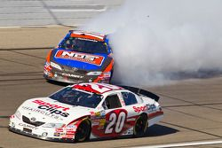 Kyle Busch spins out of turn 4 as Joey Logano passes