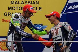 Podium: race winner Valentino Rossi, Fiat Yamaha Team, third place and 2010 MotoGP champion Jorge Lorenzo, Fiat Yamaha