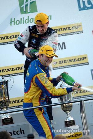 Andrew Jordan and Steven Kane spray champagne