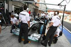 Mercedes team pull Cars into pit lane to tighten their wheel nuts