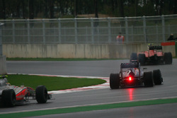 Sebastian Vettel, Red Bull Racing is passed by Fernando Alonso, Scuderia Ferrari as he retires from the race