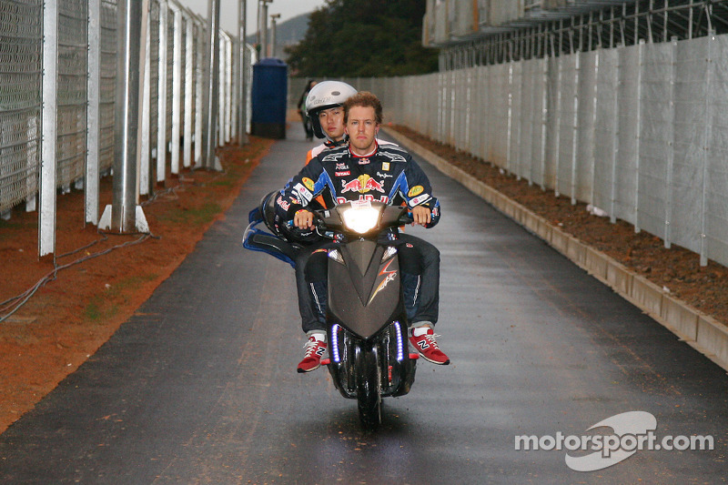 Sebastian Vettel, Red Bull Racing rides back to the pits after his engine blew