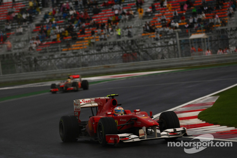 Fernando Alonso, Scuderia Ferrari leads Lewis Hamilton, McLaren Mercedes