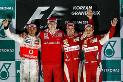 Podium: race winner place Fernando Alonso, Scuderia Ferrari, second place Lewis Hamilton, McLaren Mercedes, third place Felipe Massa, Scuderia Ferrari, and Chris Dyer, Scuderia Ferrari, Track Engineer of Fernando Alonso