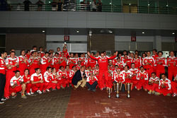 Race winner place Fernando Alonso, Scuderia Ferrari celebrates with Felipe Massa, Scuderia Ferrari, and Scuderia Ferrari team members