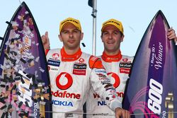 Jamie Whincup and Steve Owen celebrate victory after taking out race two of the Gold Coast 600 for T