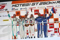 Podium GT500 Championship Champions: #18 Weider HSV-010: Takashi Kogure, Loic Duval, 2nd place: #1 P
