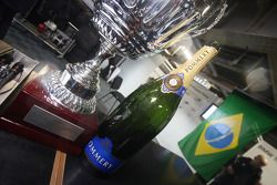 The trophy and bottle of champagne from Augusto Farfus, BMW Team RBM BMW 320si