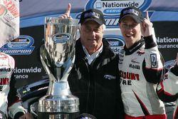 NASCAR Nationwide Series 2010 champion Brad Keselowski celebrates with Roger Penske