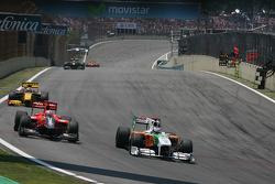 Тимо Глок, Virgin Racing и Адриан Сутиль, Force India F1 Team
