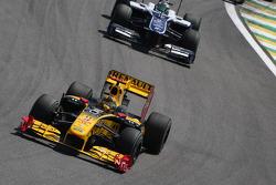 Robert Kubica, Renault F1 Team leads Rubens Barrichello, Williams F1 Team