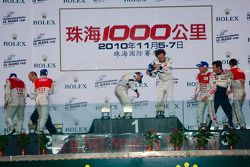 LMP1 podium: class and overall winners Stéphane Sarrazin and Franck Montagny, second place Tom Kristensen and Allan McNish, third place Rinaldo Capello and Romain Dumas