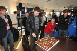Markko Martin is presented with a cake to celebrate his birthday