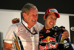 Podium: race winner and 2010 Formula One World Champion Sebastian Vettel, Red Bull Racing, with Helmut Marko, Red Bull Racing, Red Bull Advisor
