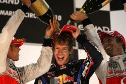 Podium: race winner and 2010 Formula One World Champion Sebastian Vettel, Red Bull Racing, second pl