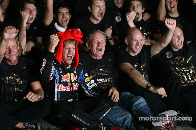 Race winner and 2010 Formula One World Champion Sebastian Vettel, Red Bull Racing, celebrates with h