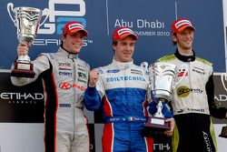 Davide Valsecchi celebrates his victory on the podium with Luiz Razia and Romain Grosjean