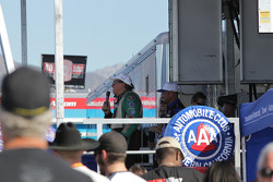 John Force (microphone) Robert Hight (near) Ashley Force Hood (far) during announcement of AAA Texas