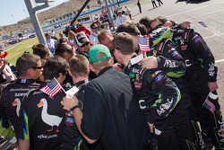 Roush Fenway Racing Ford team members confer before the race
