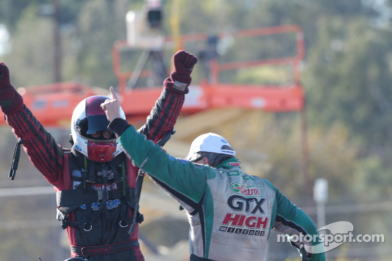 Bob Tasca III and John Force celebrate John's Funny Car World Championship and Bob's win over Tony P