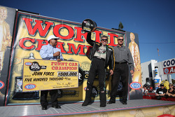 John Force celebrates his fifteenth world championship during the Auto Club NHRA Finals