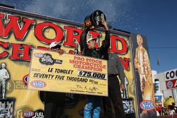 Rookie sensation LE Tonglet celebrates his first Pro Stock Motorcycle World Championship during the Auto Club NHRA Finals