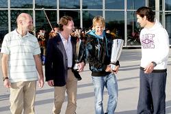 Chief technical officer Adrian Newey, team principal Christian Horner, Sebastian Vettel and Mark Webber