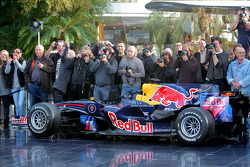 A Red Bull Racing car and photographers