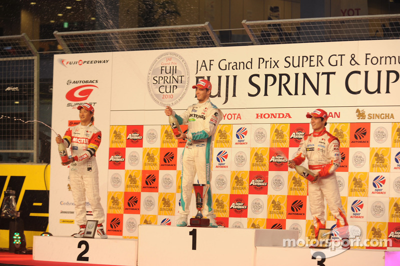Podium: winnaar Andre Lotterer, 2de Yuji Ide, 3de Naoki Yamamoto