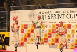 Podium: race winner Andre Lotterer, second place Yuji Ide, third place Naoki Yamamoto