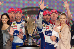 Championship victory lane: NASCAR Sprint Cup Series 2010 champion Jimmie Johnson, Hendrick Motorsports Chevrolet celebrates with Chad Knaus, wife Chandra and daughter Genevieve Marie